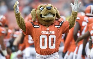 photo of Chomps the dog mascot for the cleveland browns nfl football team with his hands in the air