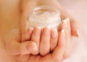 hands holding the best neck cream