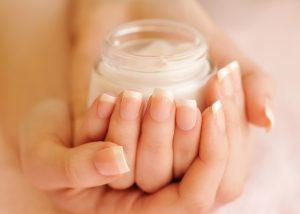 hands holding the best neck cream