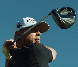 photo of a guy finishing his swing off the tee box with his cleveland golf launcher hb driver review