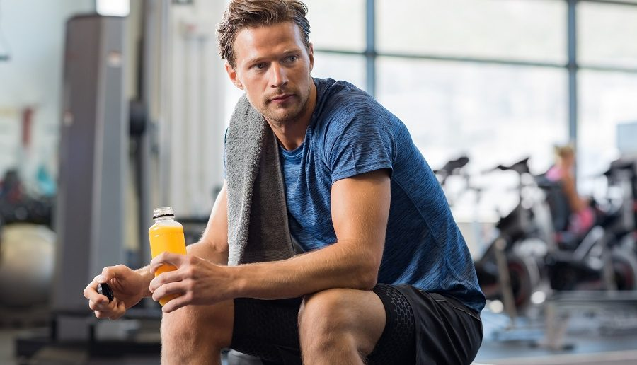 young man working out with the best beta hydroxybutyrate drink in his hand