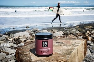 photo of the best exogenous ketones supplement, Perfect Keto, on a rock on the beach
